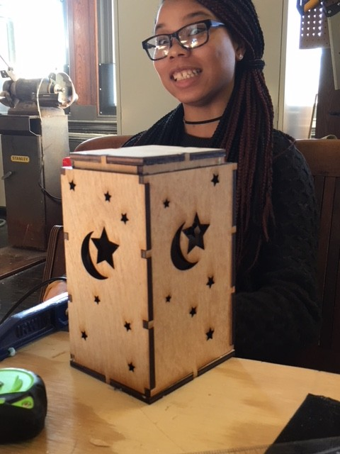 Kamiyah with one of her lasercutter projects