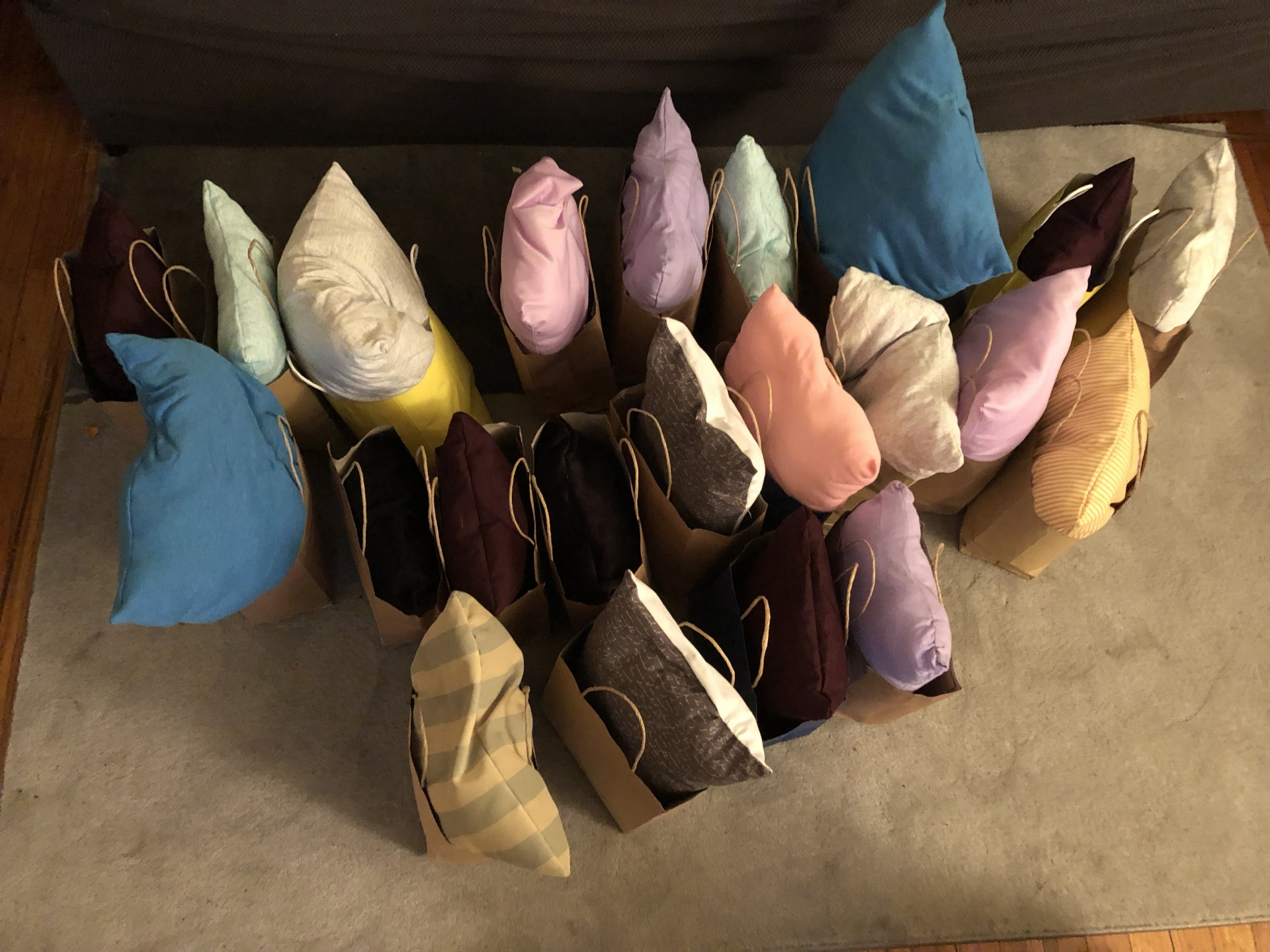 This is a picture of 22 pillows and care packages I made for a local women's shelter.